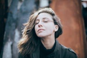 closeup photo of woman wearing black top